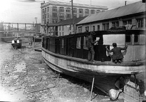 Dry docked canal boats being repaired
