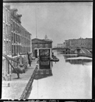 View along Erie Canal of Weighlock Building and warehouses