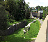 Erie Canal Lock No. 36 remains, with Lock E-17 in the background